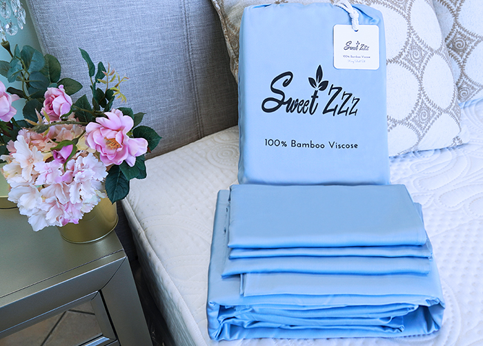 Two sets of Sweet Zzz Bamboo sheets. One folded nicely and another in packaging