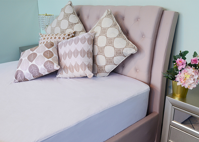 Sweet Zzz Tencel Mattress Protector on a nice bed with some throw pillows