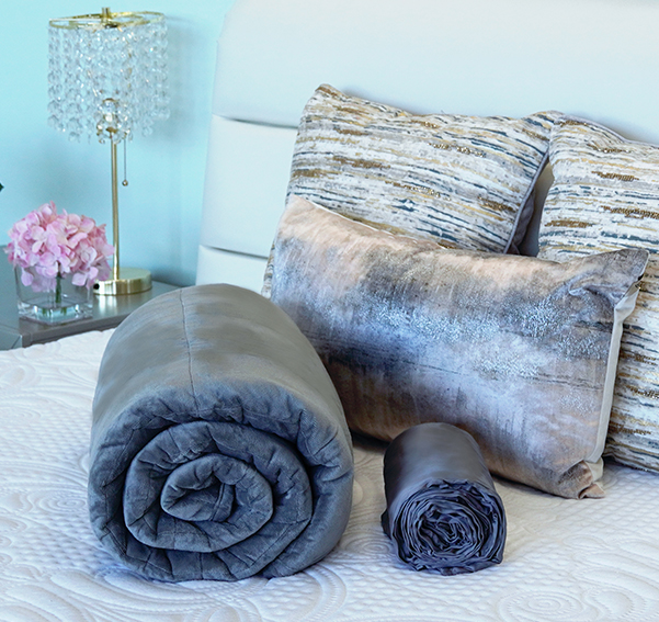 Sweet Zzz weighted blanket and bamboo duvet on a bed