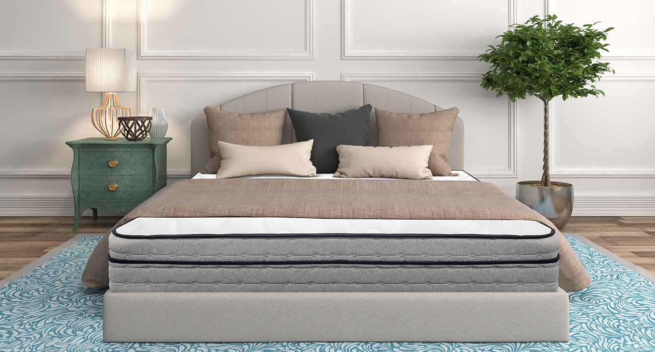 Hanna Hybrid mattress on a gray bed in a cottage style bedroom