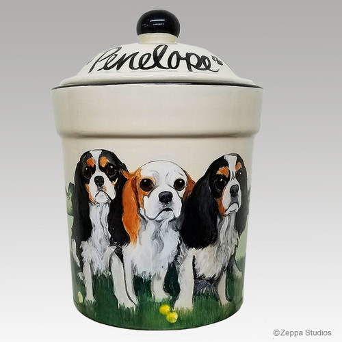 Three Cavalier King Charles Spaniels hand painted on a ceramic treat jar by Zeppa Studios.