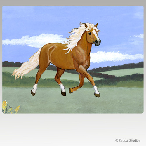 Haflinger trotting in a landscape design cutting board.