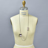 Long Black and Blush Astro Necklace, on mannequin