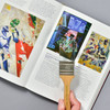 Paintbrush Magnifying Glass Natural with book being magnified