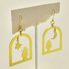 Arched Windows & Vases Brass Earrings; earrings hanging on stand
