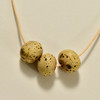 Triple Round Bead Necklace by Curious Clay, close up of beads