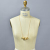 Triple Round Bead Necklace by Curious Clay, on mannequin