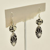 Lana Mod Polymer Earrings Black & White; hanging on stand