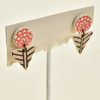 Tiny Arrow Polymer Stud Earrings, hanging on stand