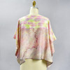 One Of A Kind Pastel Multi Shibori Blouse, showing back, on mannequin