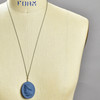 Large Indigo Porcelain Cameo Pendant on Silk Cord by Marcie McGoldrick, on mannequin