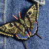 Embroidered & Beaded Swallowtail Butterfly Pin, close up, on clothes