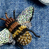 Embroidered & Beaded Honey Bee Pin, close up, on clothing