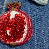 Embroidered & Beaded Pomegranate Pin, close up, on clothing