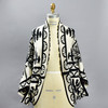 Folksong Cotton Cocoon Wrap, front, on mannequin