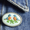 Pin Embroidered Two Birds, on clothing