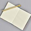 """Marbled Sketchbook 5.75"""" x 4.25"""" - Yellow/Blue/Red, open with pencil"""