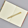 """Marbled Sketchbook 7"""" x 5"""" - yellow/blue/red French curl, opened with pencil"""