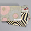 Louise Bourgeois Corkboard Placemat Set, packaging and placemats