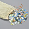 Jellyfish Vintage Puzzle, puzzle pieces spilling out of muslin bag