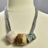Three Bead Luster Necklace by Curious Clay, Dark Grey, on mannequin