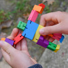 Cubebot figure being played with