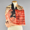 Cream, Black, and Red Chat Noir Scarf On Manikin in a Celebrity Knot