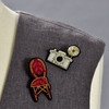 Camera and Chair pins on clothing