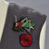 Grasshopper and Red Poppy pins on clothing