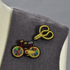 Bonsai Scissors and Bicycle pins on clothing