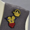 Teapot and Ramen pins on clothing