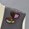 Sushi and Heart pins on clothing