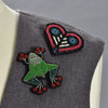 Toad and Heart pins on clothing