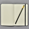 Blackwing Black Slate Notebook open with included pencil