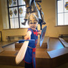 Child in tabard with sword.