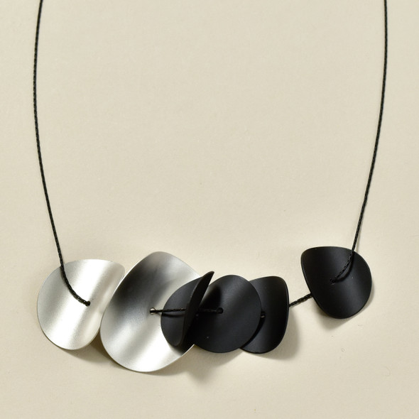 Matte Black Curved Disks Necklace, close up