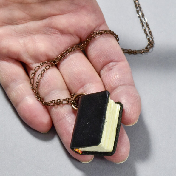 Book Necklace, black, with hand