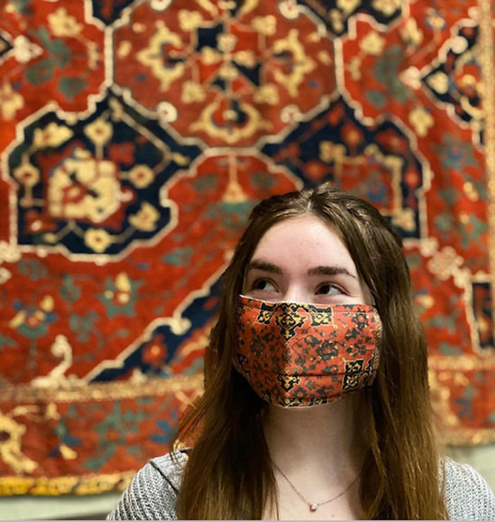 Turkish Rug Face Mask by Ana Thorne in model in front of Turkish Rug