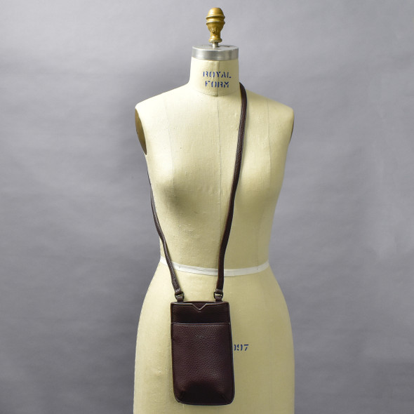 Fudge Cross Body Purse; shown worn cross body style on form