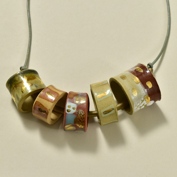 Clay Beads on Brass Bar Necklace by Curious Clay, close up of beads