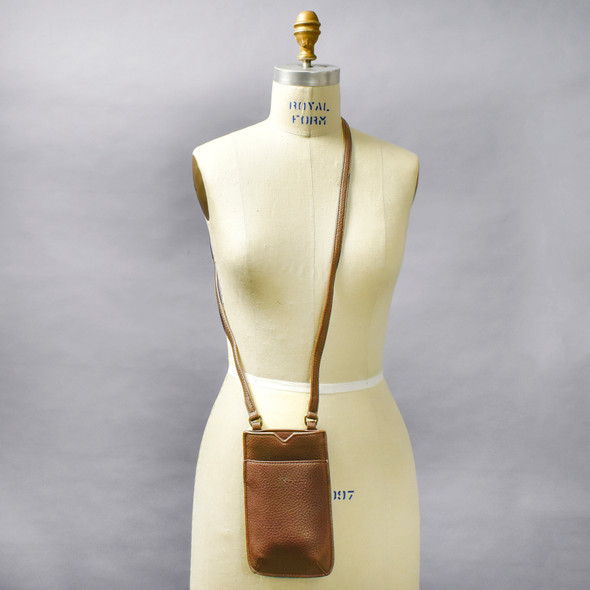 Oak Brown Cross Body Purse on mannequin