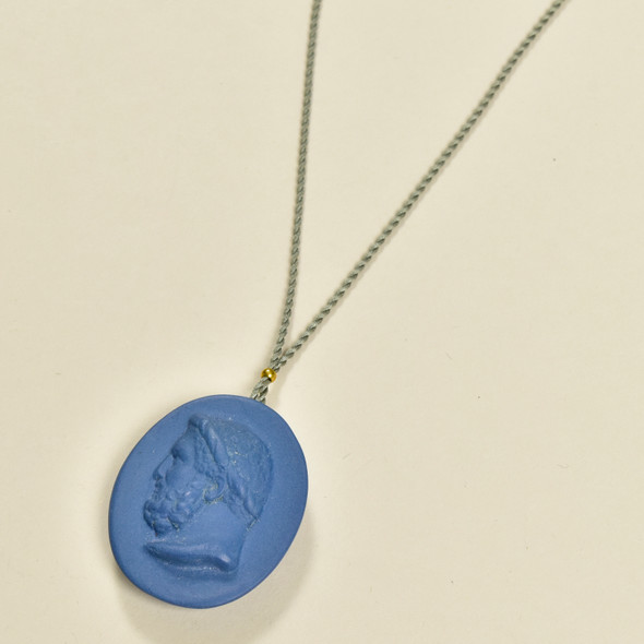 Large Indigo Porcelain Cameo Pendant on Silk Cord by Marcie McGoldrick, close up