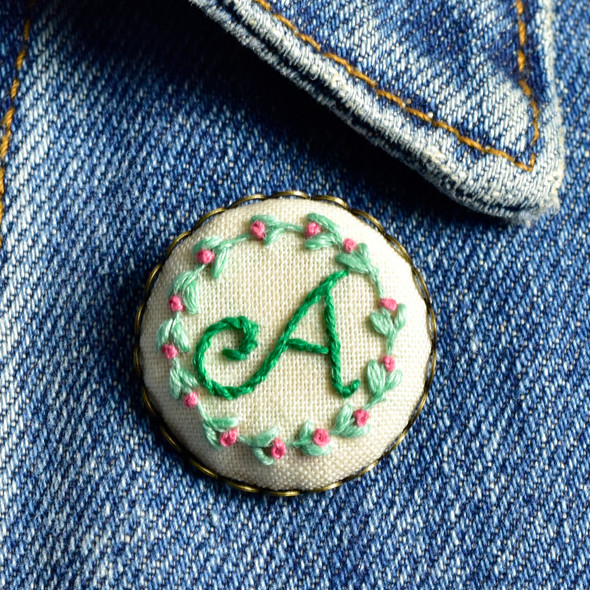 Embroidered Initial Pin by Hoop and Wheel, initial A, on clothing