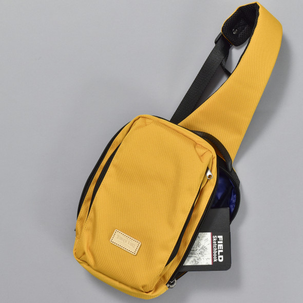 Apex Sling Pack - Mustard, with contents