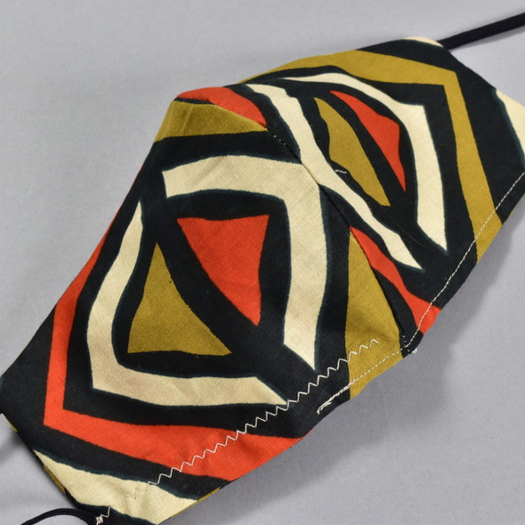 African Wax Print Orange Diamond Face Mask by Art & Soul Gallery, close up of pattern