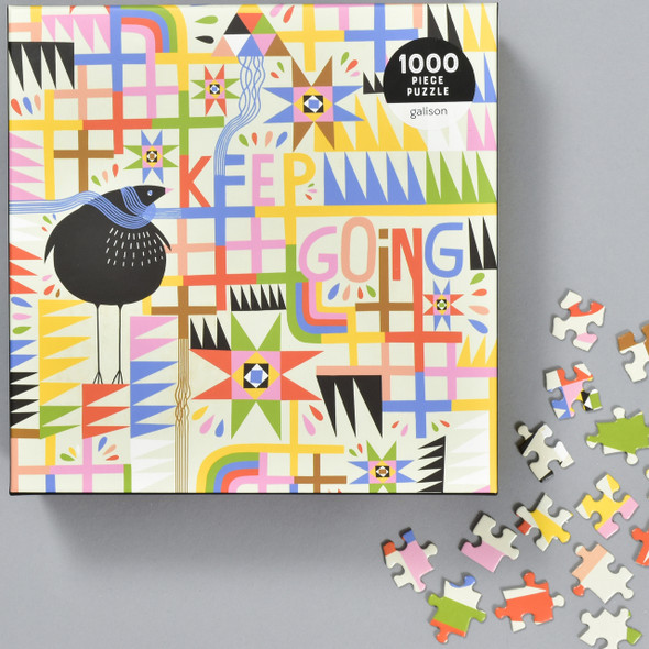 Keep Going Puzzle, front of box and puzzle pieces