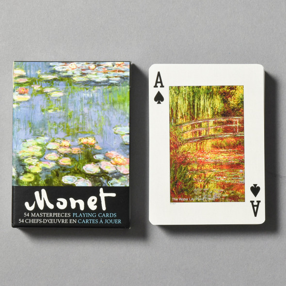 Front of packaging Monet Water Lilies Playing Cards next to card deck