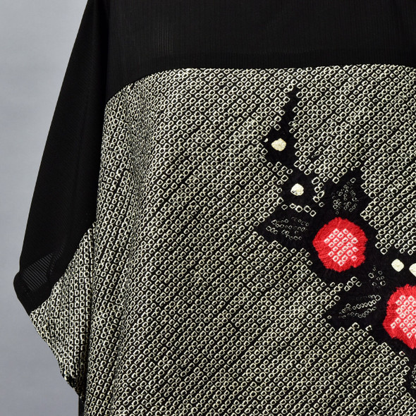 One Of A Kind Black & Red Shibori Blouse on mannequin, close up