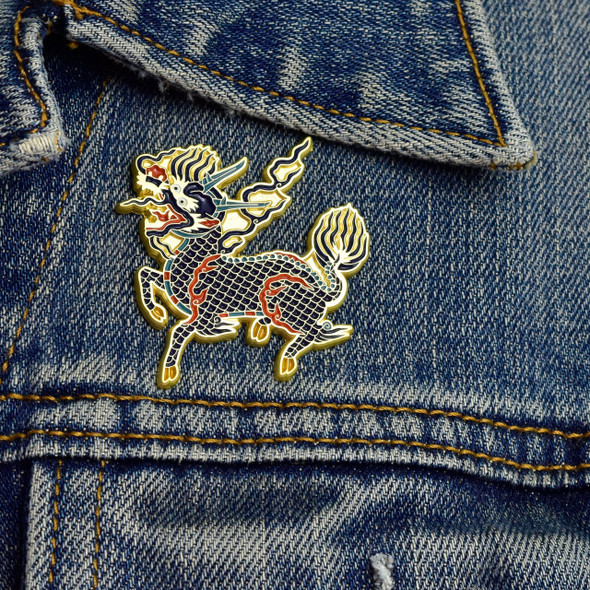 Qilin Enamel Pin on denim jacket