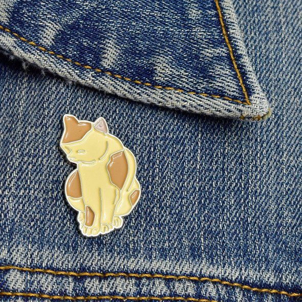 Yoshitoshi Cat Enamel Pin on denim jacket